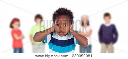 Afro-American child frightened covering his ears ang blurry children of background