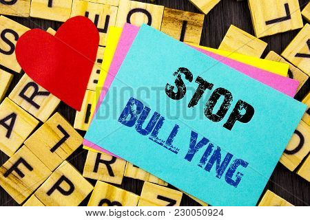 Handwritten text showing Stop Bullying. Conceptual photo Awareness Problem About Violence Abuse Bully Problem written colorful sticky note the letter background Love Heart for Loving poster