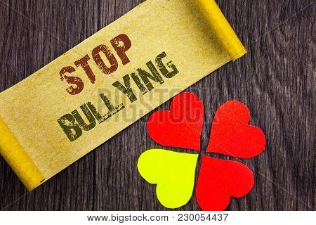 Word, writing, text  Stop Bullying. Conceptual photo Awareness Problem About Violence Abuse Bully Problem written Sticky Note Paper with Love Heart Next to it the wooden background. poster