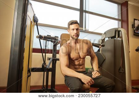 Trained man at the gym