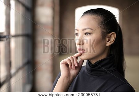 Young woman looking out of the window