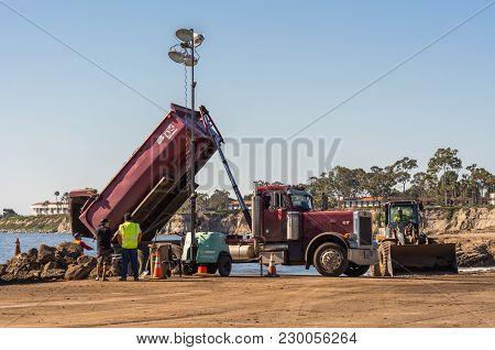 Santa Barbara, United States - Febriary 16, 2018:  Dump Truck Unloads Off-flooding Dirt From Monteci