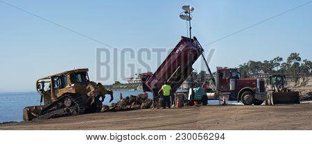 Santa Barbara, United States - Febriary 16, 2018:  Bulldozer And Dump Truck Unloading Off-flooding D