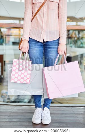 Female customer with many shopping bags as a symbol of consumption and purchasing power