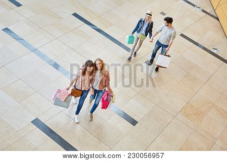 Friends go for a shopping spree in the shopping mall