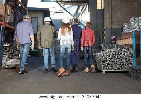 Metal factory group of metalworkers as a team