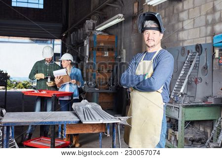 Man as worker and metalworker with experience in metallurgy workshop