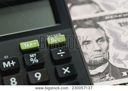 Closed Up Shot Of Tax Minus / Plus Buttons With Text Tax Rate On Calculator With Background Of Us Do