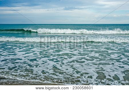 Beautiful Green Wave Next To Frisky White Waves Heading Towards The Florida Shore