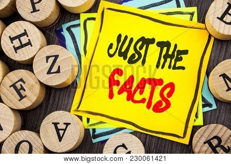 Handwriting Announcement text showing Just The Facts. Business photo showcasing Truth Fact Accuracy Honest Concept For Factual Actual  written  wooden abckground with letters poster