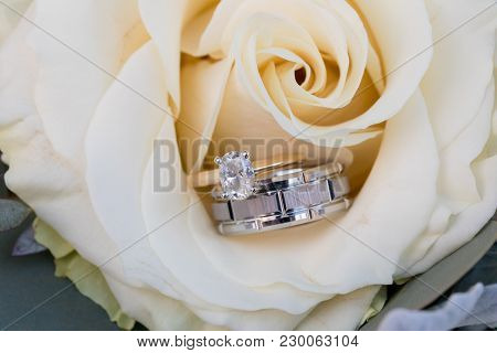 Wedding Rings On The Bouquet Of A Bride At Her Wedding Reception.