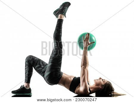 one caucasian woman exercising pilates fitness soft ball exercises isolated  silhouette on white background