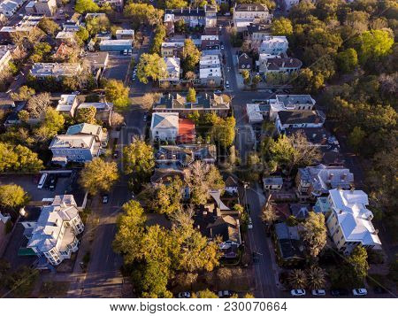 Aerial top down view of historic neighborhood in Savannah, Georgia.