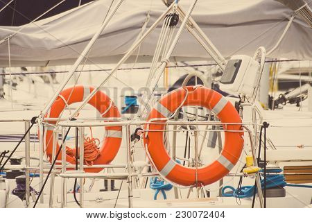 Vintage Photo, Parts And Detail Of Yachting, Orange Lifebuoy On Deck Of Sailboat, Concept Of Safety