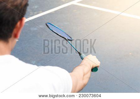 Asian Sport Man Badminton Player On Field