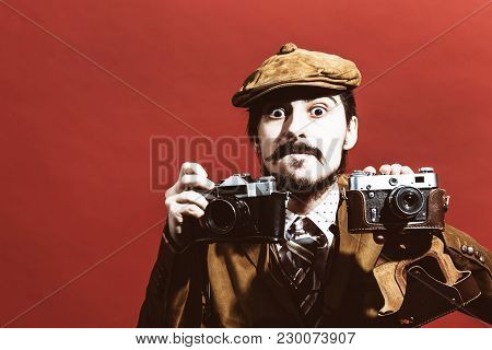 Very Positive Photographer Posing In Studio With Cameras