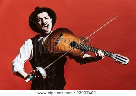 Positive Guy In The Studio Simulates A Violin