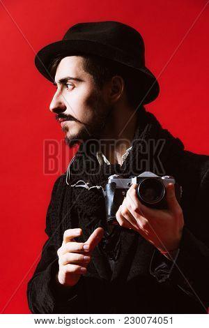 Creative Photographer Posing In Studio With Camera