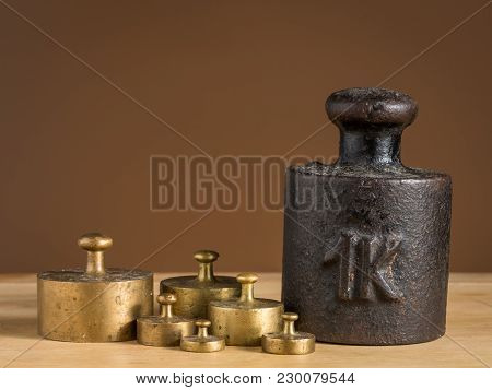 Old Iron 1Kg Weight And Smaller Brass Weights For A Kitchen Scale