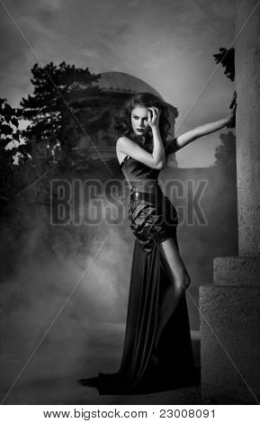 Elegant woman in black dress in black and white