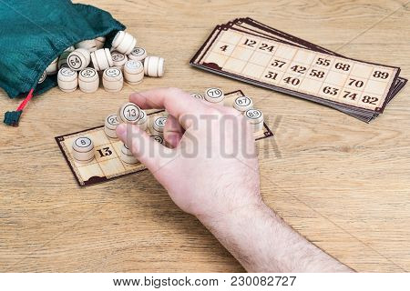 Number Thirteen In The Hands Of A Player In The Board Game Of Bingo