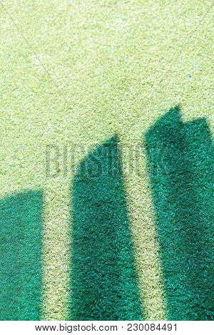 Blue / Green Colourful Shadows On Green Grass Astro Turf. Synthetic Grass