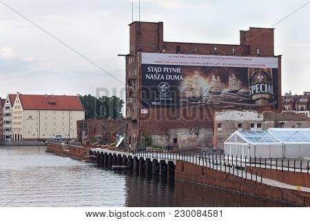 Gdansk, Poland - June 07, 2014: Old Abandoned Large Barn From Red Brick Known As