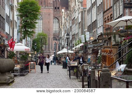 Gdansk, Poland - June 07, 2014: Unknown People Walking On The Mariacka Street In The Historical Part