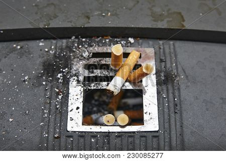 Cigarettes In An Urban Ashtray. Stop Addiction. Non Healthy Lifestyle