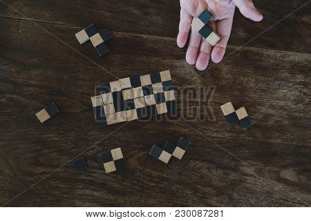 Wood Block Puzzle Game. Education & Leisure Concept. Growth, Success & Development In Business