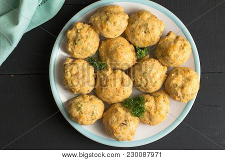Savory Muffins On A Plate. Top View Background Of Cheese  And Herb Muffins Isolated On Rustic Black