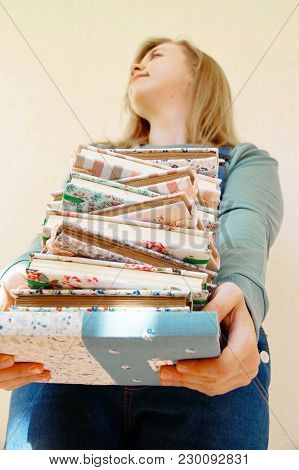 A Stack Of Handmade Notepads Against The Background Of The Girl Handmader