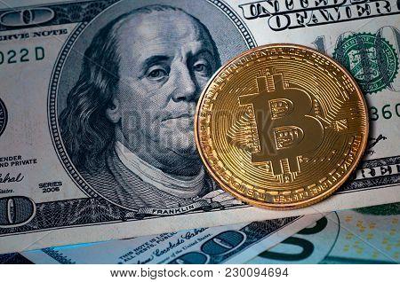 Golden Bitcoin On Us Dollar Bills. Electronic Money Concept