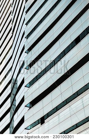 Close-up Of An Overlay Of Glass Facades That Reflect The Colors Of The Sky At Sunset, The Lines Of T