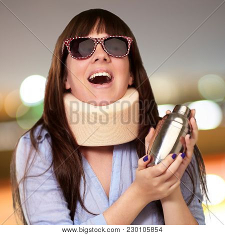 Woman Wearing Neckbrace Holding A Shaker, Outdoor