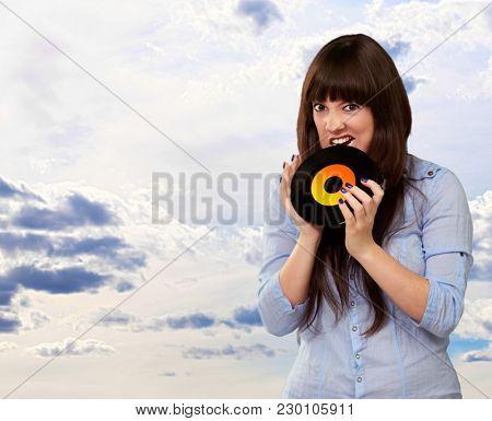 Woman Biting Disc, Outdoor