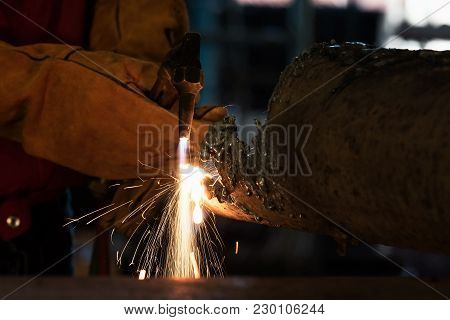 Closeup Of Industrial Worker At The Factory Welding With Protective Mask.teamwork Concept.
