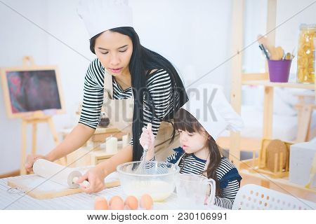 Happy Family Cooking Biscuits Together In Kitchen.family And Relaxing Concept.