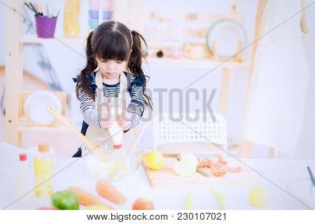 Young Little Girl Chef Preparing Vegetable Soup In Kitchen,family And Relaxing Concept