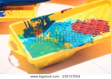 Mixed Acrylic Colors In A Yellow Plastic Box