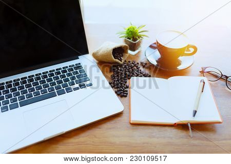 Laptop,notebook,and Coffee At Coffee Shop,online And Business Concept.