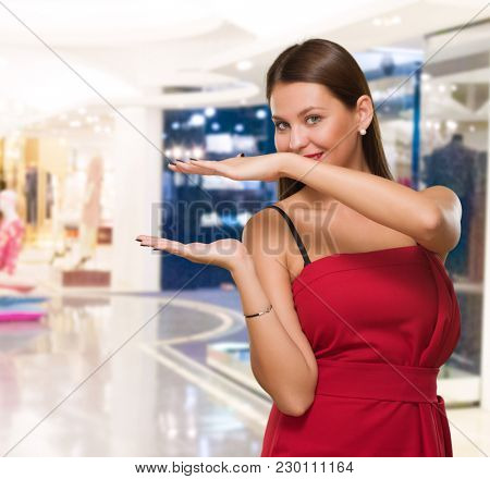 Young Woman Showing Hand Gap in a clothes shop