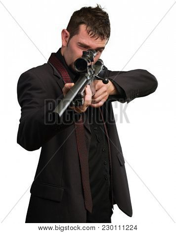 Man in suit pointing with a rifle