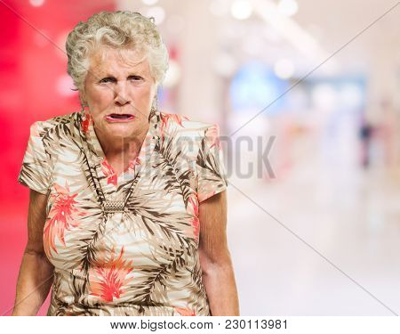Portrait Of Angry Senior Woman, Indoors