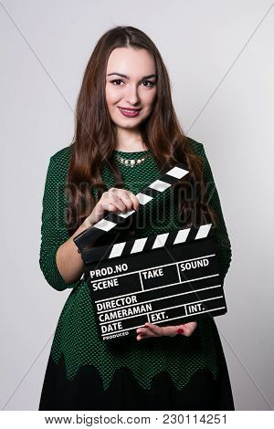 Young Woman Holding A Movie Clapper.