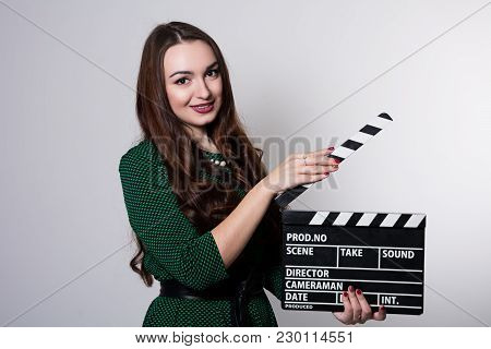 Young Woman Holding A Movie Clapper