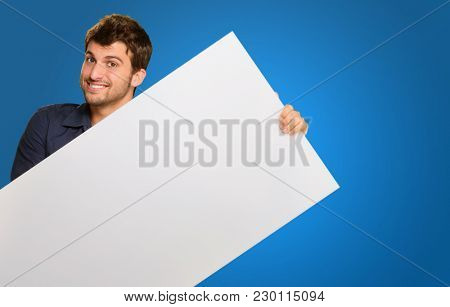 Young Man Holding Banner On Blue Background