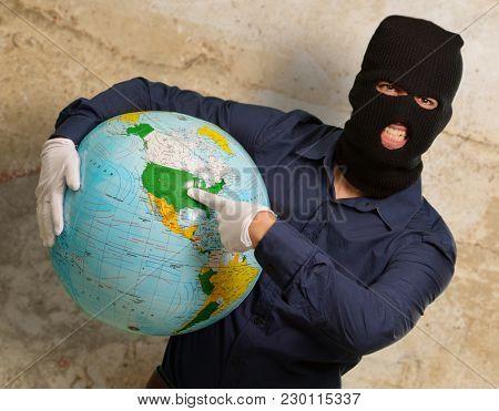 Burglar Man Holding Globe, Indoors