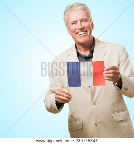 Mature Man With French Flag against a blue background