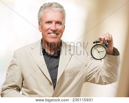 Man Holding Alarm Clock, indoor